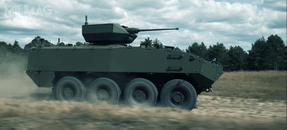 GDELS-MOWAG Piranha 5zezdalnie sterowanym modułem uzbrojenia Rafael Samson RCWS z30-/40-mm armatą automatyczną, 7,62-mm sprzężonym karabinem maszynowym, wyrzutniami granatów dymnych ipodwójną wyrzutnią dla rodziny ppk Spike / Zdjęcie: GDELS