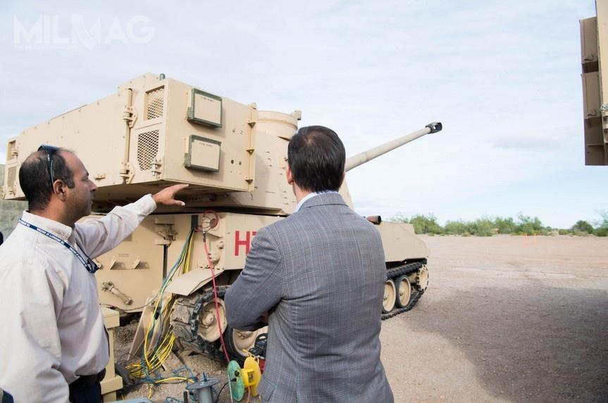 Na potrzeby testów zmodyfikowaną wieżę posadowiono nakadłubie M109A6 Paladin, aoprócz dłuższej lufy haubicy, zastosowano nowy zamek ihamulec wylotowy.